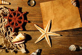 Card blank with sea star and shells on wooden background — Stock Photo