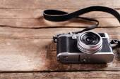 Old retro camera on rustic wooden planks background — Stock Photo