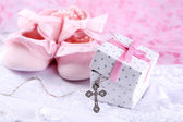 Baby shoe and cross for Christening — Stock Photo