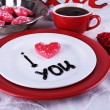 Cookie in form of heart on plate with inscription I Love You on color wooden table background — Stock Photo #68605241