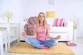 Young woman doing yoga at home — Stock Photo