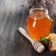 Delicious honey with honeycomb on table close-up — Stock fotografie #68613013