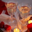 Champagne glasses and rose petals for celebrating Valentines Day on dark background — Stock Photo #68728559