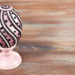Easter egg on rustic wooden table background — Stock Photo #68730681