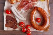Assortment of deli meats on parchment, top view — Stock Photo