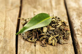Green tea with leaf on old wooden table — Stockfoto