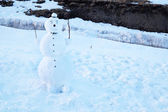 Funny snowman over snow in wintertime — Stock Photo