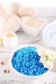 Spa still life with color sea salt on wooden table, closeup — Stock Photo