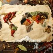 Map of world made from different kinds of spices on wooden background — Stock Photo #68793103