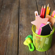 Colorful pencils with paper notes in metal stand on wooden table background — Stock Photo #68794693