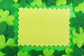 Greeting card for Saint Patrick's Day with shamrocks on green background — Stock Photo
