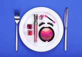 Makeup accessories on plate on colorful background — Stock Photo