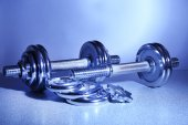 Dumbbells on floor background — Stock fotografie