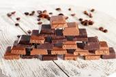 Pyramid of squared chocolate on wooden table — Stock Photo