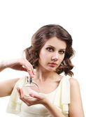 Beautiful woman with perfume bottle isolated on white — Stock Photo
