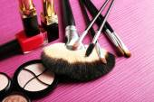 Set of colorful cosmetics on pink wooden table background — Stock Photo
