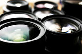Set of modern camera lenses, closeup — Stock fotografie