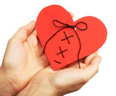 Female hands holding stitched heart isolated on white — Stock Photo
