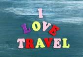 Inscription I love travel on wooden background — Stock Photo