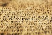 Grunge paper with hieroglyphics close up — Stock Photo