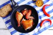 Smoked chicken with vegetables and mustard on pan on table close up — Stock Photo
