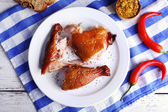 Smoked chicken with vegetables on plate on table close up — Stock Photo