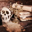 Still life with human skull, retro book and quill on wooden table, closeup — Stock Photo #68852277