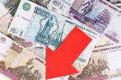 Red arrow on Russian money as depreciation of currency, closeup — Stock Photo