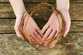 Crown of thorns in hands, close up — Stock Photo