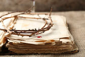 Crown of thorns with blood and bible, close up — Stock Photo