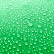 Water drops on glass on green background — Stock Photo #69197677
