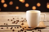 Cup of coffee on table on brown background — Stock Photo