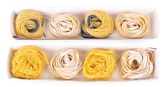 Packaged pasta tagliatelle nests isolated on white — Stock Photo
