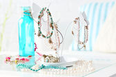 Decorative stand with jewelry and bijouterie on table in room — Stock Photo
