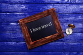 Travel inscription on wooden background — Stockfoto