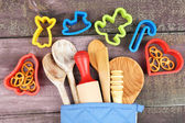 Different kitchen utensils in potholder — Stock Photo