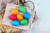 Easter eggs  on wooden tray, on colorful background — Foto de Stock