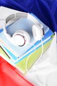 Books and headphones on French flag background — Stock Photo