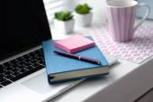 Laptop, notebook on windowsill — Stock Photo