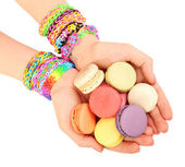 Female hands with bracelets and pile of macaroons isolated on white — Stock Photo