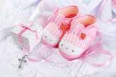 Baby shoes and cross — Stock Photo