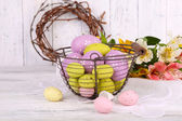 Easter eggs in basket and flowers — Stock Photo
