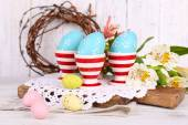 Easter eggs and flowers — Stock Photo