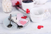 Heart shaped teabag tags, box and teapot on wooden background — Stock Photo