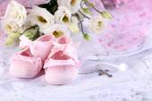 Baby shoe, flowers and cross for Christening — Stock Photo