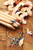 Wooden colorful pencils with sharpening shavings — Stock Photo