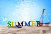 Word summer on beach sand — Stock Photo