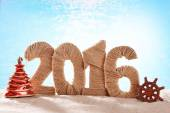New year 2016 sign on beach sand — Stock Photo