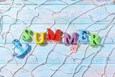 Word summer on wooden background — ストック写真