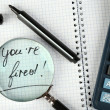 Message You're Fired on notebook with calculator, marker and magnifying glass on wooden table, closeup — Stock Photo #69356957